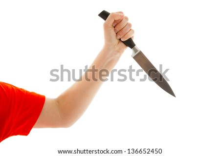 The young woman holds a knife in his hand - stock photo