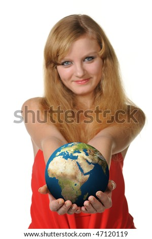The young woman holds the globe in hands. It is isolated on a white background