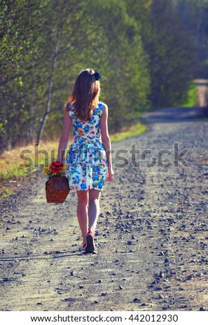 The young woman on walk. Summer, rest, vacation. The photo is tinted in a retro style.