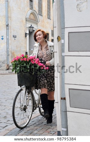 The young woman portrait with roses in the bike - stock photo