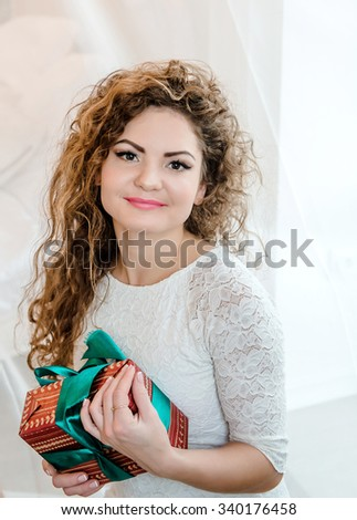 the young woman receives gifts - stock photo