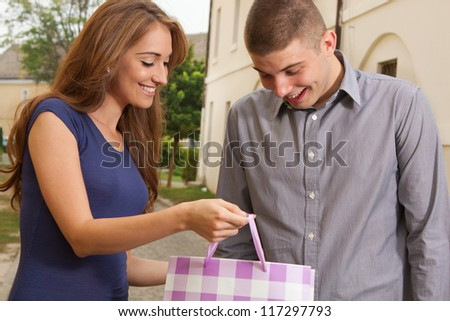 The young woman shows what she bought