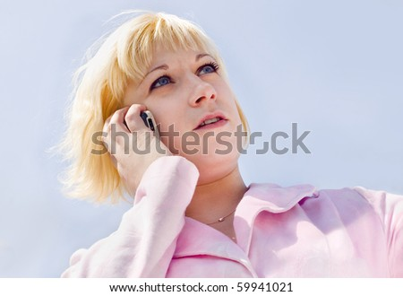 The young woman speaks on the phone - stock photo