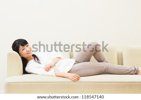 The Young woman who lies in a sofa
