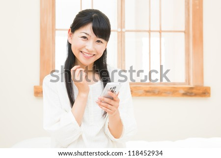 The Young woman who uses the smart phone