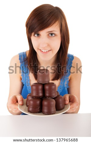 The young woman with a plate full of chocolate marshmallow - stock photo