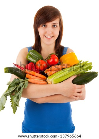 The young woman with her arm full of vegetables