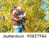 The young woman with the daughter on walk in park - stock photo