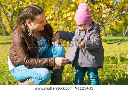 The young woman with the daughter on walk in park