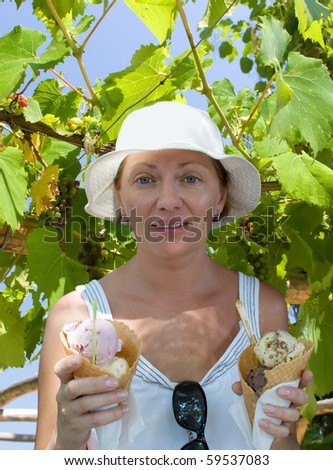 The young woman with two portions of ice-cream - stock photo