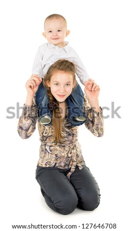 the younger brother of sitting by her sister's neck isolated on white background - stock photo
