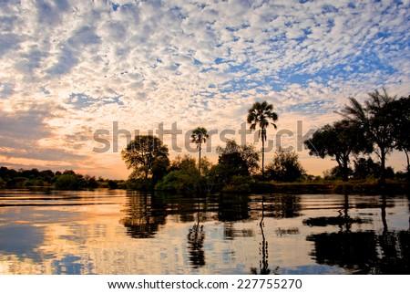 The Zambezi river at sunset, Zambia - stock photo