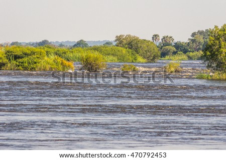 The Zambezi River  in Zambia  just upstream from Victoria Falls and  flowing with vast amounts of water