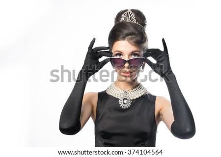 Theater and film actress wears glasses - stock photo