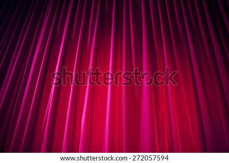 Theater curtain with dramatic lighting - stock photo