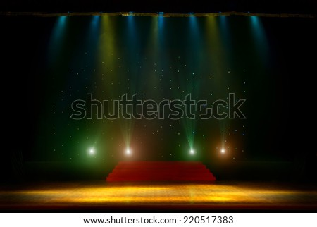 Theater stage with curtains and spotlights. Theatrical scene in the light of searchlights, the interior of the old theater. Light stage spotlights.