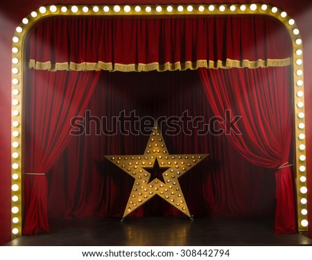 Theater stage with red curtains and spotlights. Theatrical scene in the light of searchlights  - stock photo
