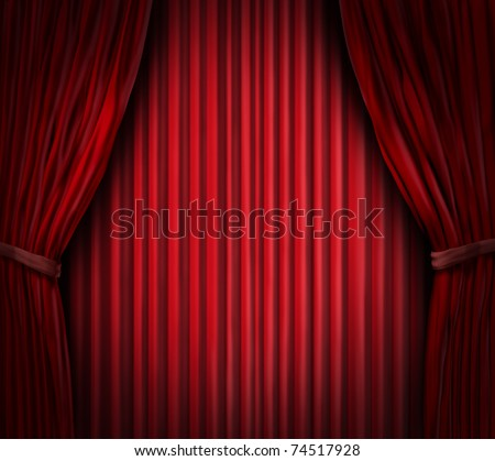 Theater stage with spot light on red velvet cinema curtain drapes.