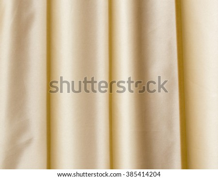 Theater stage yellow curtains ready to open for a live performance  - stock photo