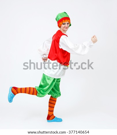 Theatre actress in fairy tale costume of elf on white - stock photo