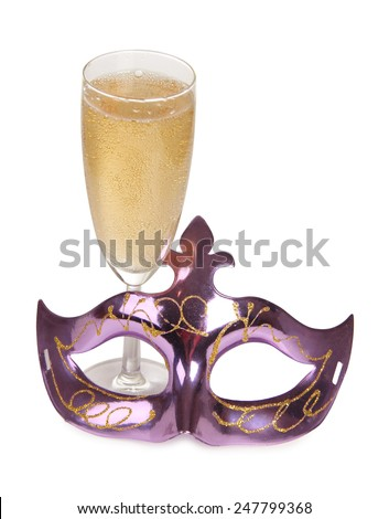 Theatrical mask and champagne glass on a white background