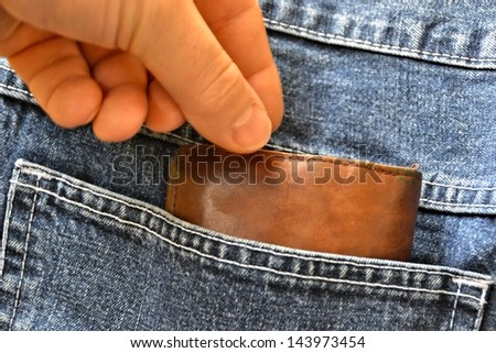 Theft of a purse from a pocket - stock photo