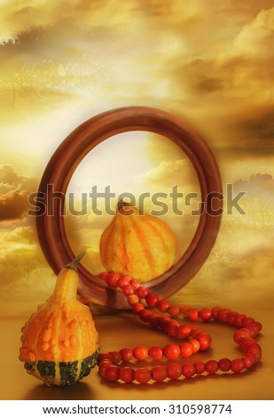 Theme of indian summer. Late Love - an divine gift from heaven. Couple of pumpkins as symbol of a creative force of nature. Beads of rowanberry, as a sign of unquenchable love, talisman of well being.