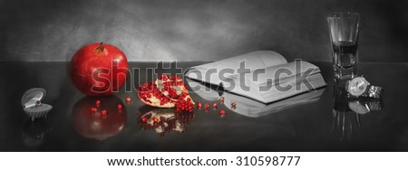 Theme of relationship of man and woman. The part of pomegranate in the form of heart  symbolizes passion, and the open book symbolizes continuation of history... Panoramic image from several pictures.