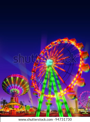 theme park motor rides game in evening view isolated on night view blue purple sky background - stock photo