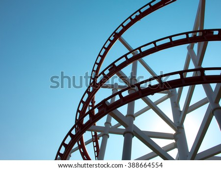 Theme Park Rollercoaster against blue sky . - stock photo