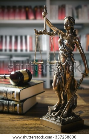 Themis and gavel in court library. Law conception - stock photo