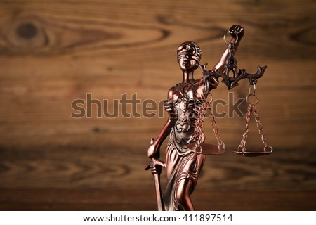 Themis on wooden background - stock photo