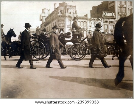 Theodore Roosevelt in carriage on Pennsylvania Avenue on way to Capitol, March 4, 1905 is flanked by officers of the Secret Service. - stock photo