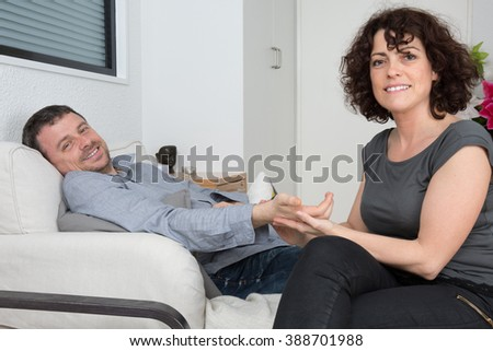 Therapist comforting her upset patient at therapy session