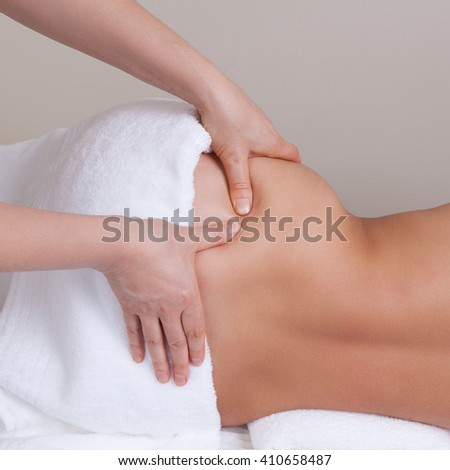Therapist doing pressure point massage on a woman's hip