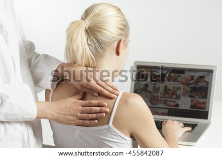 Therapist giving a massage on a woman's neck in office