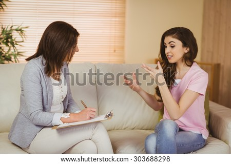 Therapist listening to her patient in therapists office