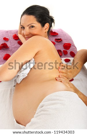 Therapist man massaging back to pregnant woman on table against white background