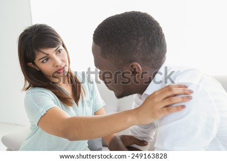 Therapist reassuring her depressed patient at therapy session