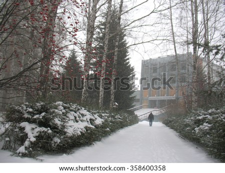 There are alley, man silhouette and snow - stock photo