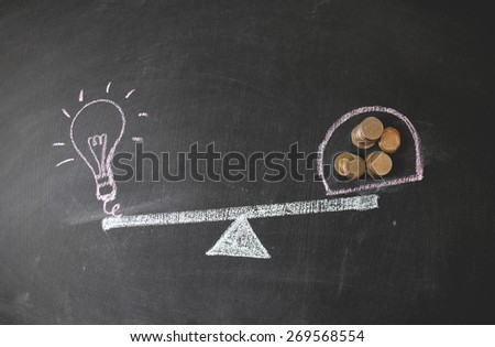 There are golden and silver foreign currencies are on black background. Mostly are US, UK and EU currencies. This photo may use as Financial background. Concept is drawing by colored chalk.  - stock photo