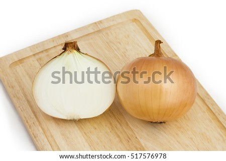 There are  onions on a cutting board.