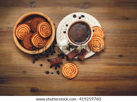 There are Pieces of  Roll with Poppyseed,Cookies,Halavah,Chocolate Peas,Tasty Sweet Food on the Wooden Background,Top View - stock photo