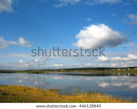 There are  river, sky and clouds - stock photo