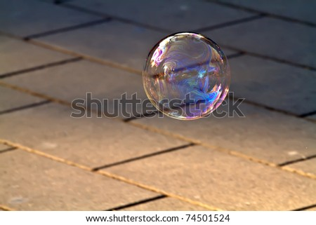 There are two kinds of dreams, one is like the harsh road, tough and practical, the other is like the soap bubble, beautiful and fragile. What kind of dream have we chosen? - stock photo