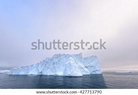 There is a big iceberg on the picture, all glaciers are melting onnorth pole.