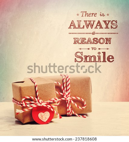 There is always a reason to smile with cute little presents - stock photo