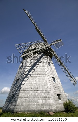 There is an old windmill  flour production - stock photo