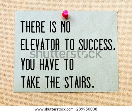 There is no Elevator To Success, You Have to Take The Stairs written on paper note pinned with red thumbtack on wooden board. Business conceptual Image - stock photo