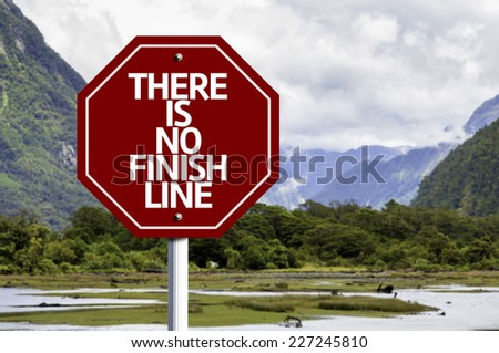 There is No Finish Line written on red road sign with landscape background - stock photo